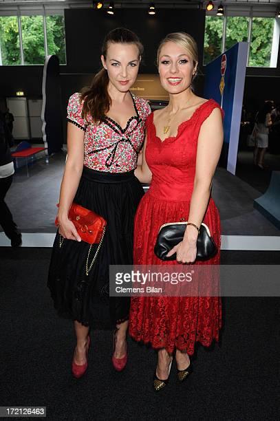Annika Kipp and Ruth Moschner attend the Lena Hoschek Show during MercedesBenz Fashion Week Spring/Summer 2014 at Brandenburg Gate on July 2 2013 in...