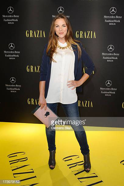 Annika Kipp attends the MercedesBenz Fashion Week Berlin Spring/Summer 2014 Preview Show by Grazia at the Brandenburg Gate on July 1 2013 in Berlin...