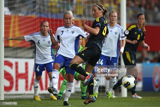 Annika Kukkonen of Finland defends against Kosovare Asllani of Sweden during the UEFA Women's EURO 2013 Group A match between Finland and Sweden at...