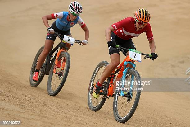 Annika Langvad of Denmark and Emily Batty of Canada race during the Women's Cross-Country Mountain Bike Race on Day 15 of the Rio 2016 Olympic Games...