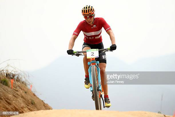 Annika Langvad of Denmark races during the Women's Cross-Country Mountain Bike Race on Day 15 of the Rio 2016 Olympic Games at the Mountain Bike...
