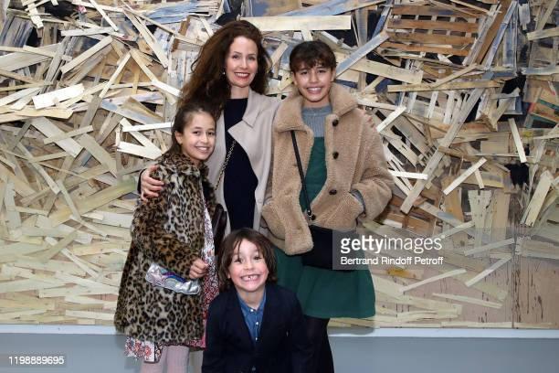 Annika Mennour and her childrens Kija Elyas and Mia attend Tadashi Kawamata and Christian de Portzamparc during La Galette Des Rois King's Cake...