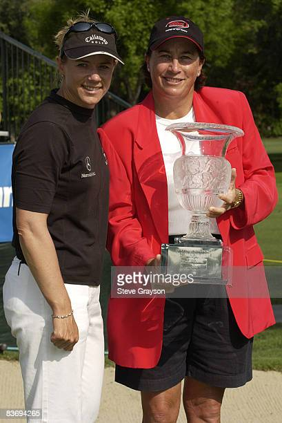 Annika Sorenstam and Amy Alcott pose with the winner's trophy on the 18th green after winning the LPGA's 2004 Office Depot Championship Hosted by Amy...