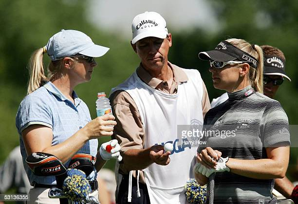 Annika Sorenstam and sister Charlotta Sorenstam of Sweden chat on the sixth hole during the practice round of the 2002 US Women's Open at the Cherry...