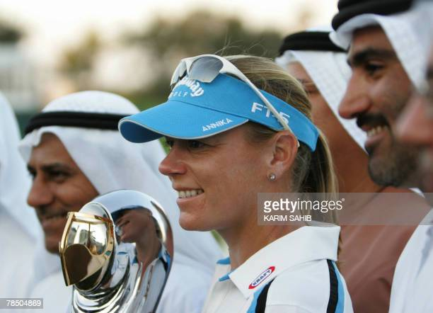 Annika Sorenstam from Sweden holds the trophy after winning the final round of the Dubai Ladies Masters in Dubai, 16 December 2007. AFP PHOTO/Karim...