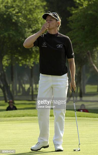 Annika Sorenstam kisses her ball and tosses it into the gallery on the 18th green after winning the LPGA's 2004 Office Depot Championship Hosted by...