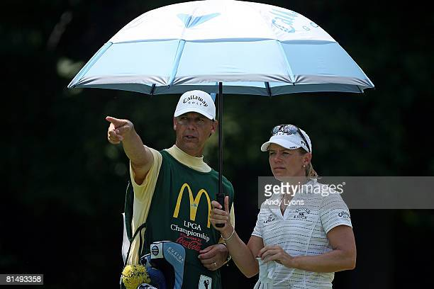 Annika Sorenstam of Sweden and her caddie line up a shot on the 4th hole during the final round of the McDonald's LPGA Championship at Bulle Rock...