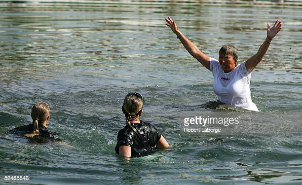 Annika Sorenstam of Sweden celebrates in Champions Lake with her sister Charlotta and her mother Gunilla after Annika won the LPGA Kraft Nabisco...