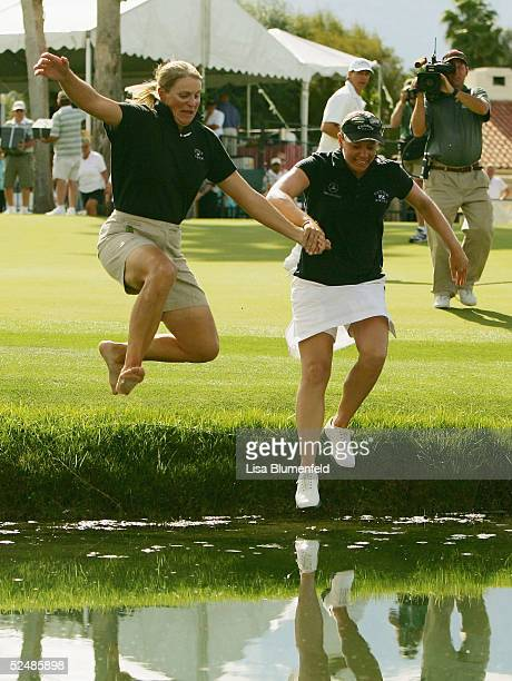 Annika Sorenstam of Sweden celebrates with her sister Charlotta Sorenstam by jumping into the water at the 18th green after Annika won the LPGA Kraft...