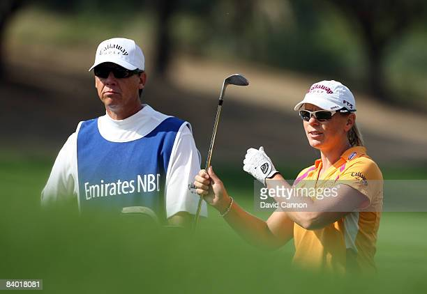Annika Sorenstam of Sweden chooses her club for her third shot at the 3rd hole during the third round of the Dubai Ladies Masters on the Majilis...