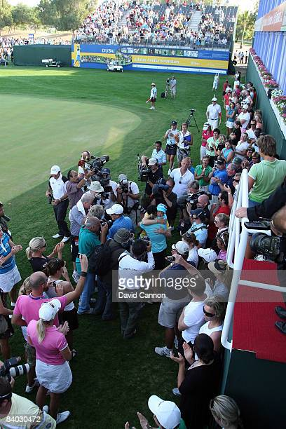Annika Sorenstam of Sweden embraces her sister Charlotta Sorenstam as she leaves the green after scoring a birdie at the 18th hole during her final...