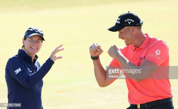 Annika Sorenstam of Sweden flicks away a challenge by Henrik Stenson of Sweden as they pose for a pictured ahead of the Scandinavian Mixed Hosted by...