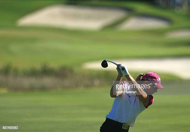 Annika Sorenstam of Sweden hits her second shot on the third hole during the first round of the ADT Championship at the Trump International Golf Club...