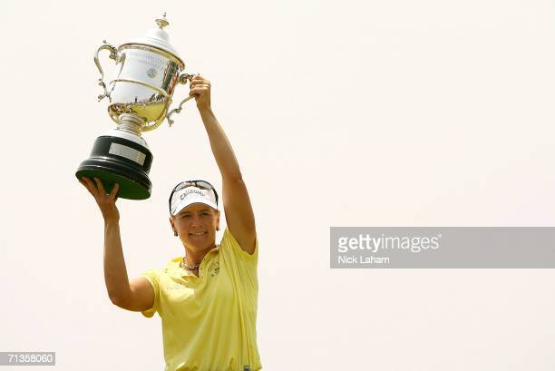 Annika Sorenstam of Sweden holds the US Open Championship trophy aloft after the playoff of the 2006 US Women's Open on July 3 2006 at Newport...