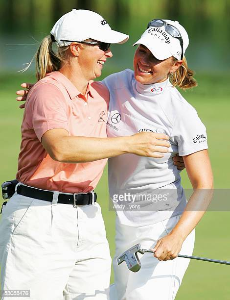 Annika Sorenstam of Sweden hugs her sister Charlotta Sorenstam after winning the McDonald's LPGA Championship on June 12 2005 at Bulle Rock Golf...