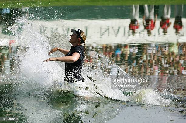 Annika Sorenstam of Sweden jumps into Champions Lake after winning the LPGA Kraft Nabisco Championship 2005 at the Mission Hills Country Club March...