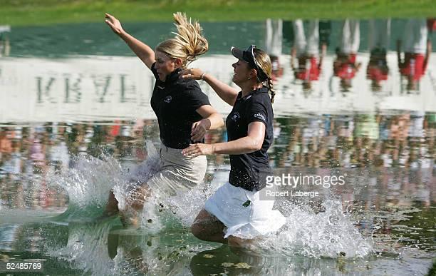 Annika Sorenstam of Sweden jumps into Champions Lake with her sister Charlotta Sorenstam after winning the LPGA Kraft Nabisco Championship 2005 at...