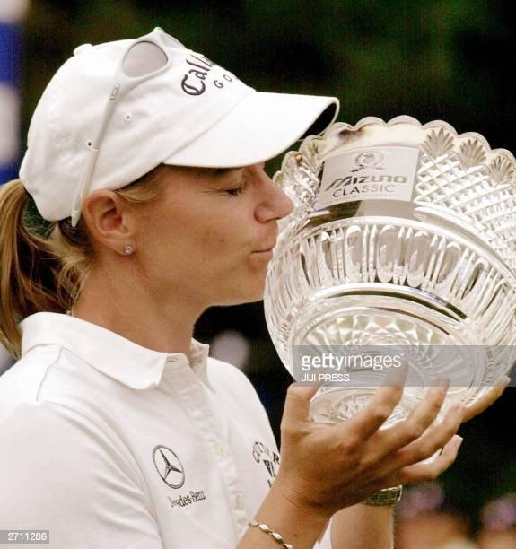 Annika Sorenstam of Sweden kisses the trophy at an award ceremony in the Mizuno Classic golf tournament at Seta Golf Course in Otsu city western...