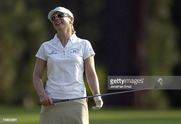 Annika Sorenstam of Sweden laughs after a shot during a practice round prior to the start of the US Women's Open Championship at Pine Needles Lodge...