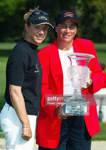 Annika Sorenstam of Sweden poses with Amy Alcott and the winner's trophy after winning the Office Depot Championship on April 4 2004 at the El...