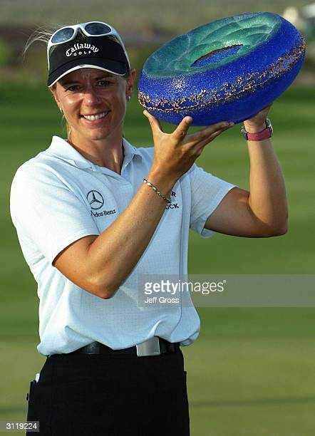 Annika Sorenstam of Sweden poses with the trophy after winning the Safeway International on March 21 2004 at the Superstition Mountain Golf and...