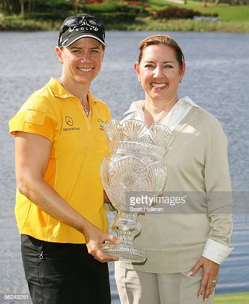 Annika Sorenstam of Sweden poses with the trophy as LPGA Commissioner Carolyn Bivens stands next to her after Sorenstam's twostroke victory at the...