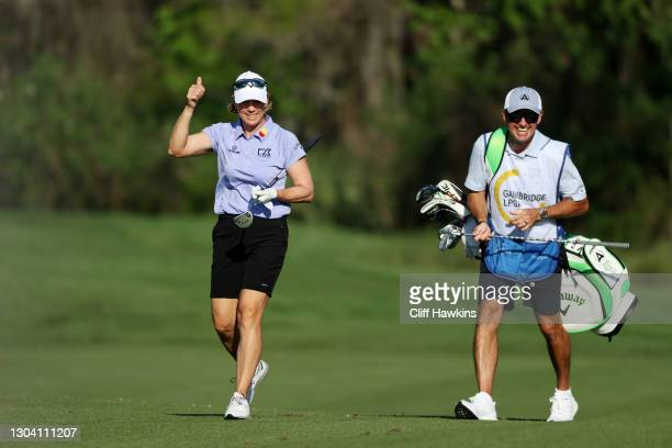 Annika Sorenstam of Sweden reacts after almost holing out on the 14th as he caddie and husband Mike McGee looks on during the first round of the...