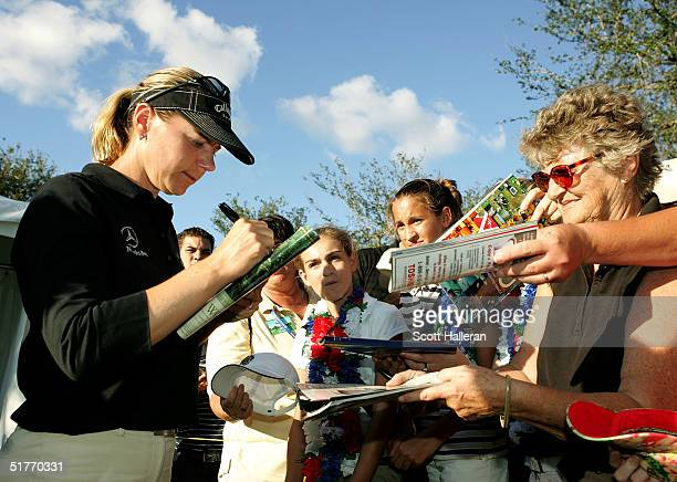 Annika Sorenstam of Sweden signs autographs for fans during the third round of ADT Championship at the Trump International Golf Club on November 20...