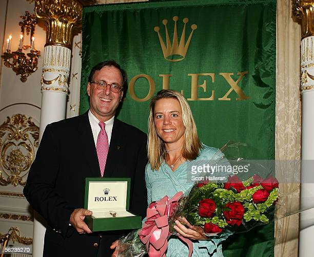 Annika Sorenstam of Sweden, the 2005 Rolex Player of the Year poses with Peter Nicholson of Rolex during the 2005 LPGA awards reception at the...