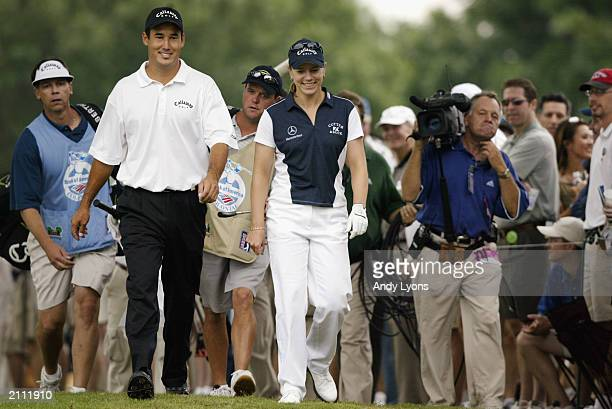 Annika Sorenstam of Sweden walks with Dean Wilson during the first round of the Bank of America Colonial at the Colonial Country Club on May 22 2003...