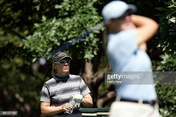 Annika Sorenstam of Sweden watches her sister Charlotta Sorenstam of Sweden tee off on the ninth hole during the practice round of the 2002 US...