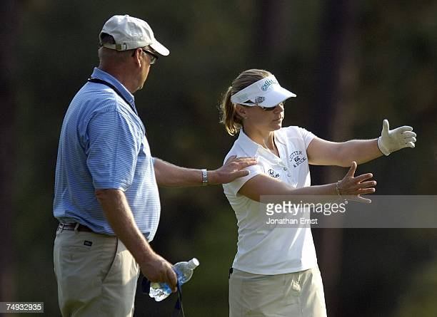 Annika Sorenstam of Sweden works with her coach Henri Reis during a practice round prior to the start of the US Women's Open Championship at Pine...