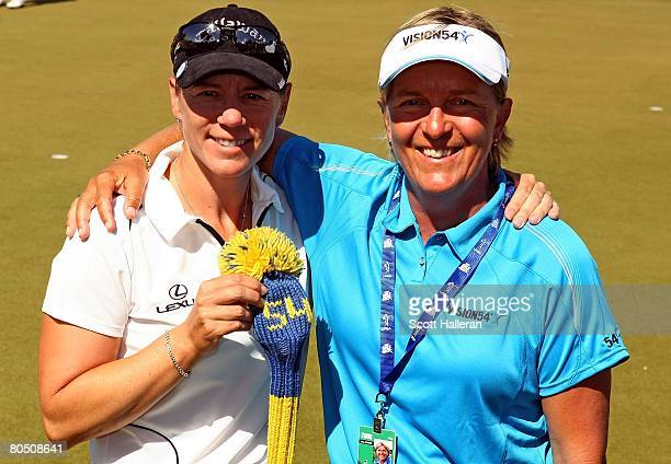 Annika Sorenstam poses with one of her instructors Pia Nilsson during the second round of the Safeway International at Superstition Mountain Golf and...