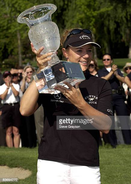 Annika Sorenstam poses with the winner's trophy on the 18th green after winning the LPGA's 2004 Office Depot Championship Hosted by Amy Alcott at the...