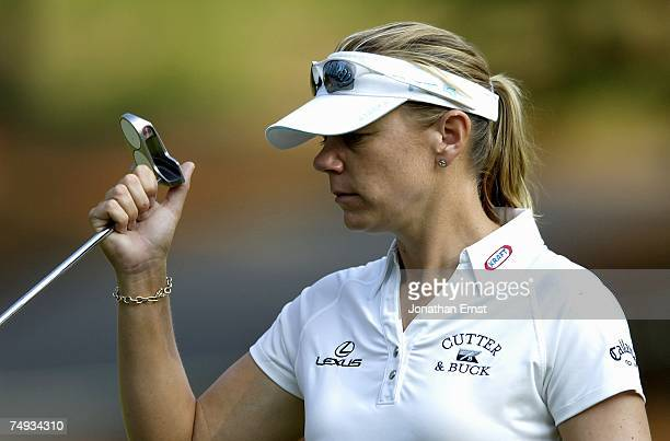 Annika Sorenstam puts her putter away on the third green during a practice round prior to the start of the US Women's Open Championship at Pine...