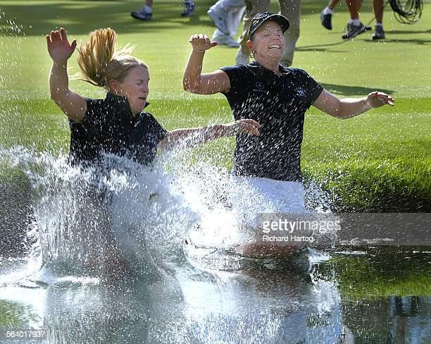 Annika Sorenstam right celebrates with her sister Charlotta Sorenstam by jumping into the water at the 18th green after winning the LPGA's Kraft...