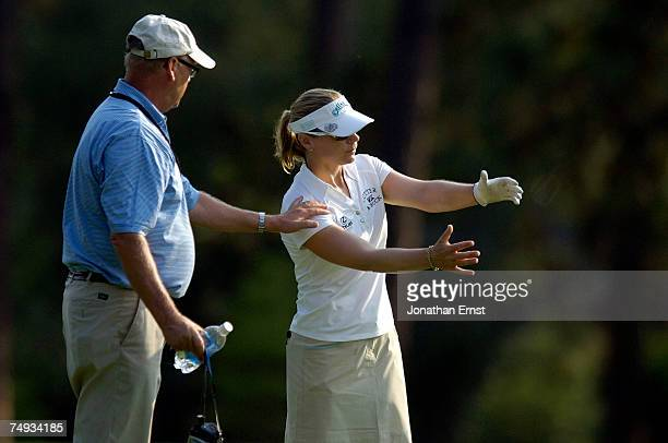 Annika Sorenstam works on the mechanics of her swing with her coach Henri Reis on the 3rd fairway during a practice round prior to the start of the...