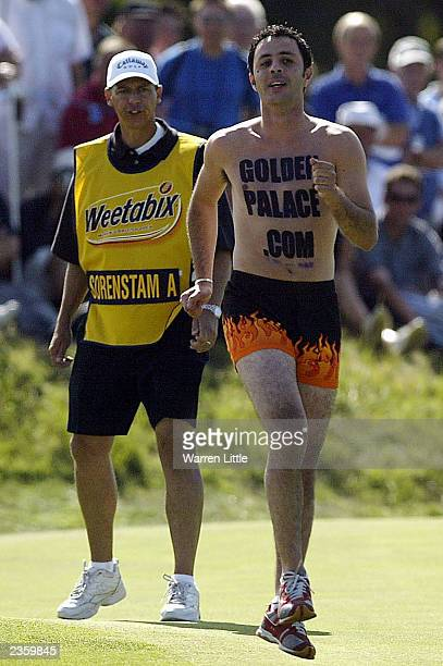 Annika Sorenstam's caddie chases off a streaker on the 15th green during the final round of the Weetabix Womens British Open with a score of 10 under...