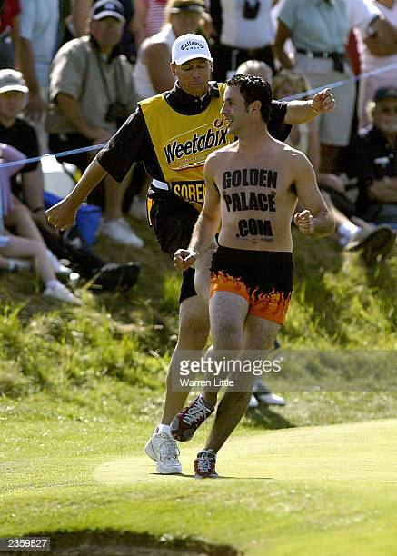 Annika Sorenstam's caddie kicks out at a streaker on the 15th green during the final round of the Weetabix Womens British Open with a score of 10...