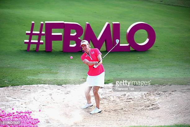 Annika Sörenstam Sweden plays a shot from a bunker on the 17th hole ahead of the Fatima Bint Mubarak Ladies Open at Saadiyat Beach Golf Club on...