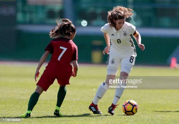 Annika Wohnen of U16 Girls Germany challenges Maria Leonor of U16 Girls Portugal during UEFA Development Tournament match between U16 Girls Portugal...