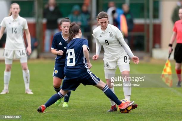 Annika Wohnen of U16 Girls Germany challenges Olivia King of U16 Girls Scotland during UEFA Development Tournament match between U16 Girls Germany...