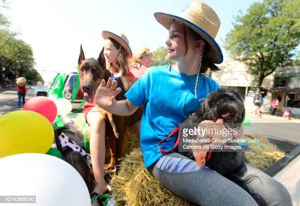 Annika Young with Marley the dog rides on the 4H Dog Club float during the annual Boulder County Fair Parade in Longmont Colorado on Saturday August...