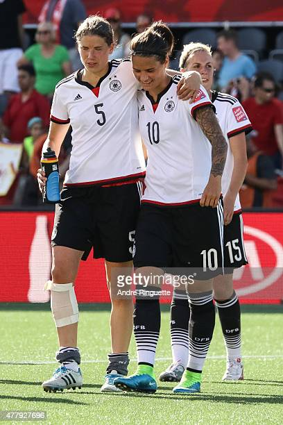 Annike Krahn and Dzsenifer Marozsan of Germany celebrate their win after the FIFA Women's World Cup Canada 2015 round of 16 match between Germany and...