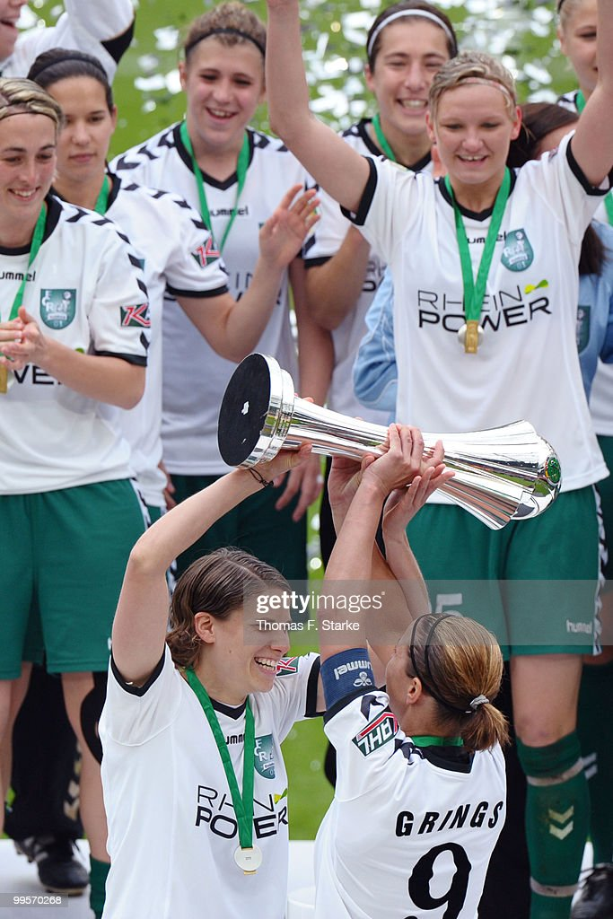 Annike Krahn (front L) and Inka Grings (front R) celebrate after the DFB Women's Cup final match between FCR 2001 Duisburg and FF USV Jena at RheinEnergie stadium on May 15, 2010 in Cologne, Germany.