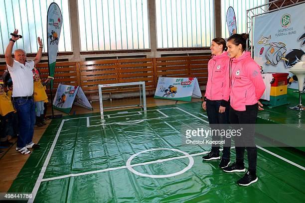 Annike Krahn and Lisa Weiss of Germany Women's Football Team visit the Gemeinschaftsgrundschule Lauenburger Allee on November 23 2015 in Duisburg...