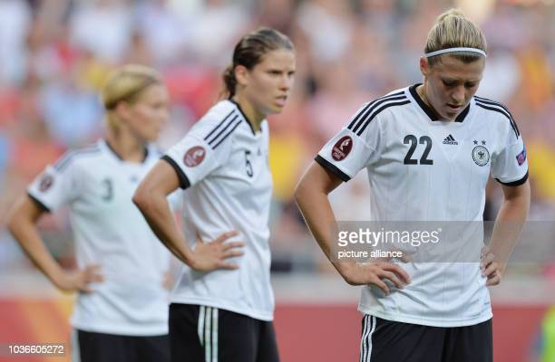 Annike Krahn and Luisa Wensing of Germany react during the UEFA Women's EURO 2013 Group B soccer match between Germany and Norway at the Kalmar Arena...