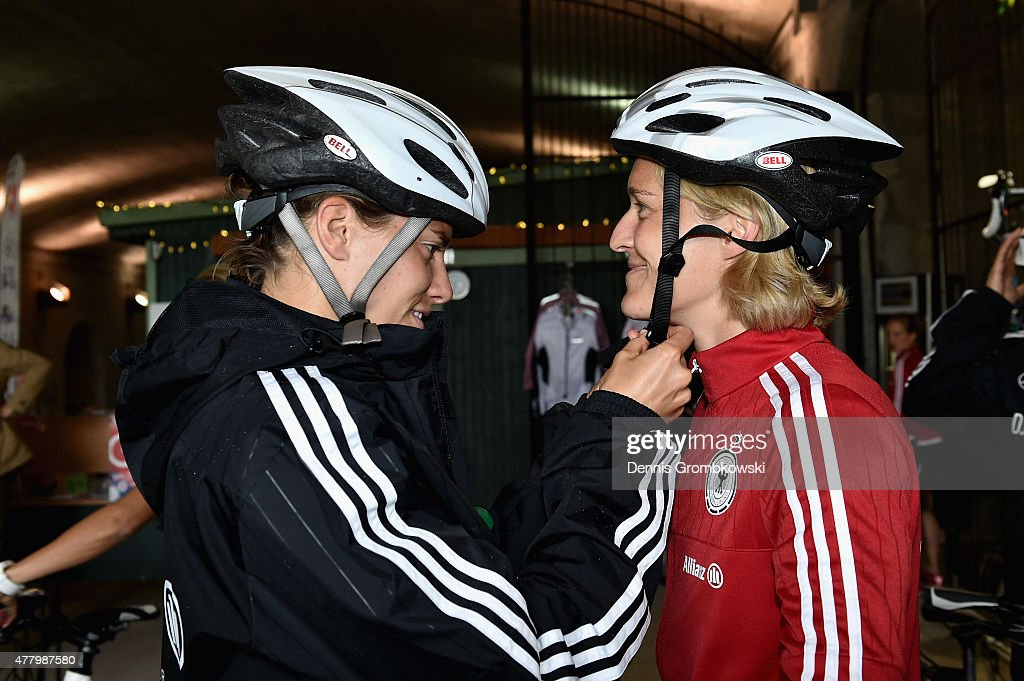 Annike Krahn and Saskia Bartusiak of Germany prepare to take a bike ride on June 21, 2015 in Ottawa, Canada.