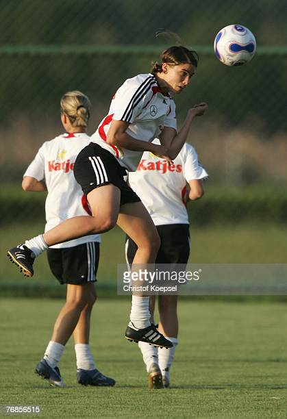 Annike Krahn does a header during the Women's German National Team training session on the training ground at the Wuhan Sports Center Stadium on...