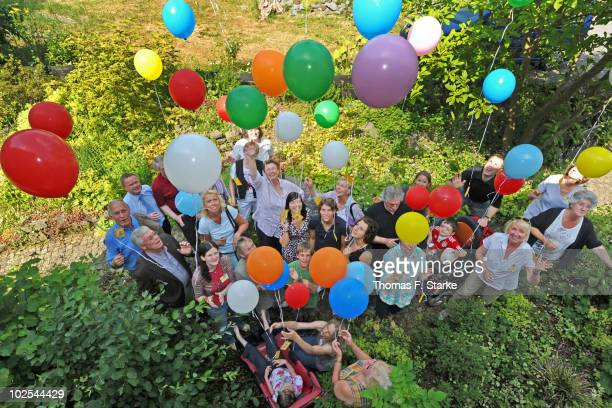 Annike Krahn , german women's national team player, poses with guests and visitors during her visit of the Childrens Hospice on June 30, 2010 in...